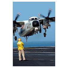 A US Navy officer observes a C2A Greyhound aircraf Poster