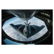 A B2 Spirit bomber refuels from a KC135 Stratotank Framed Print