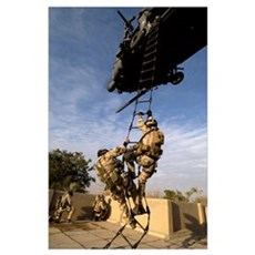 Air Force pararescuemen are extracted by an HH60G  Poster
