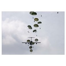 Army Soldiers jump out of a C17 Globemaster III Framed Print