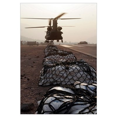 Marines attach sling loads to the body of an Army Canvas Art