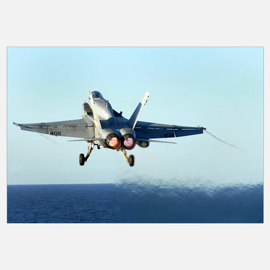 An F/A18C Hornet launches from the flight deck of