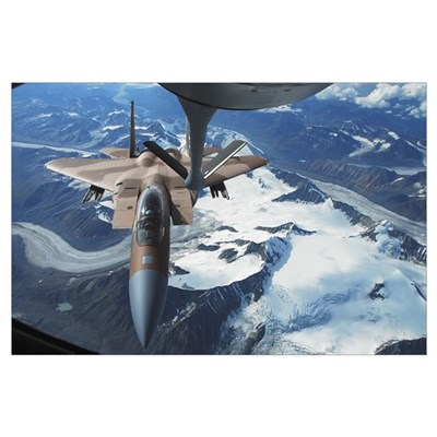 An F15C Eagle aircraft sits behind a KC135R Strato Poster