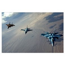 F15 Eagles and a F16 Fighting Falcon fly in format Poster