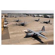 C130 Hercules aircraft stationed at an airbase Poster