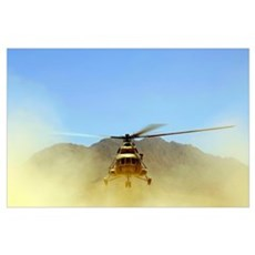 A Mi17 Hip helicopter hovers over a firing range i Poster