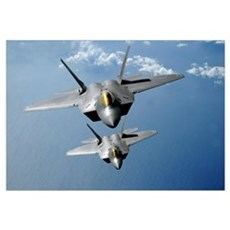 Two F22 Raptors fly over the Pacific Ocean Canvas Art