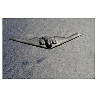 A B2 Spirit flies over the Pacific Ocean Poster