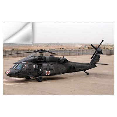A UH60 Blackhawk Medivac helicopter sits on the fl Wall Decal