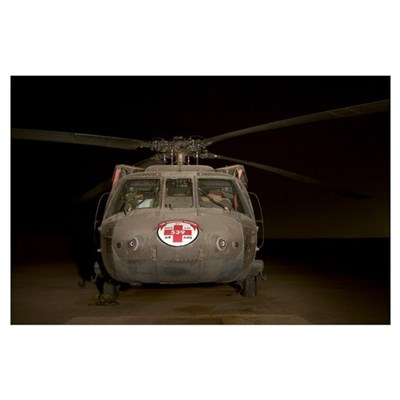 A UH60 Blackhawk Medivac helicopter sits on the fl Poster