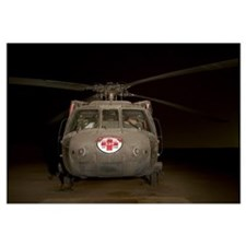 A UH60 Blackhawk Medivac helicopter sits on the fl