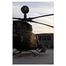 An OH58D Kiowa helicopter during sunset Poster