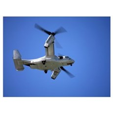 An Osprey tiltrotor aircraft in flight Poster