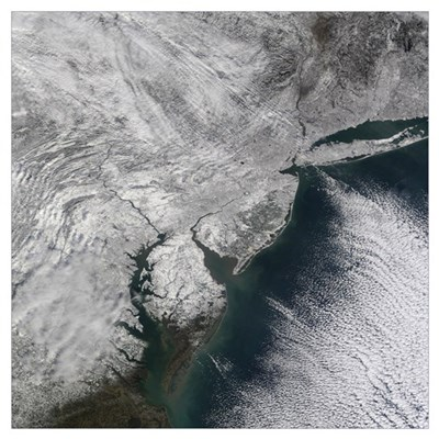 Satellite view of a Noreaster snow storm over the Poster