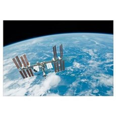 The International Space Station backdropped by Ear Framed Print