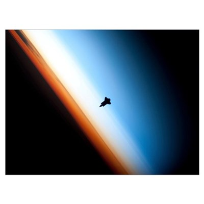 Silhouette of space shuttle Endeavour over Earths Poster