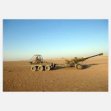 A 105mm light gun being towed by an all terrain ve