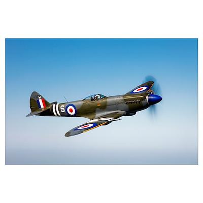 A Supermarine Spitfire Mk 18 in flight Poster