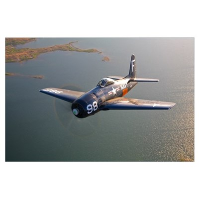 A Grumman F8F Bearcat in flight Poster