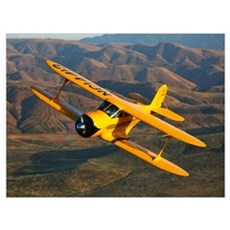 A Beechcraft D 17 Staggerwing in flight Framed Print