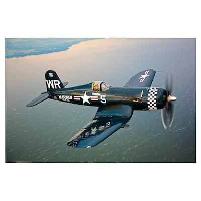 A Vought F4U 5 Corsair in flight Poster