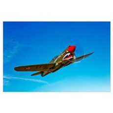 A P 40E Warhawk in flight Poster