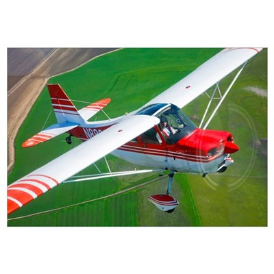 A Champion Aircraft Citabria in flight Canvas Art