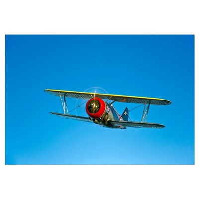 A Grumman F3F biplane in flight Canvas Art