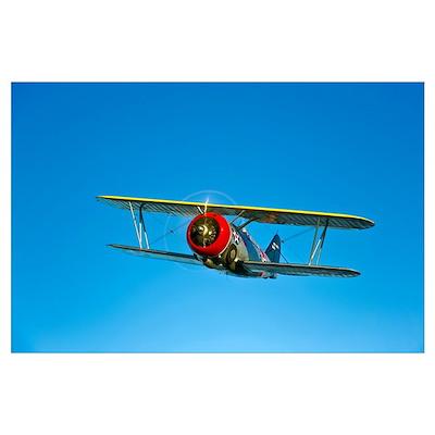 A Grumman F3F biplane in flight Poster