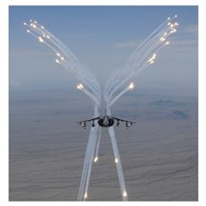 An AV 8B Harrier fires flares during a training fl Poster