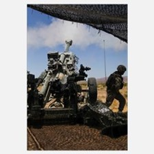 U.S. Marines fire an M777 howitzer