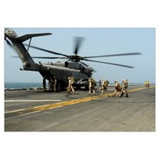U.S. Marines prepare to board a CH 53E Super Stall