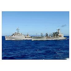 USS Denver and USNS Pecos conduct a replenishment  Poster