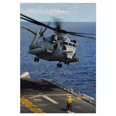 A CH 53E Sea Stallion helicopter takes off from am Framed Print