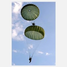 U.S. Army Soldiers parachute down after jumping fr