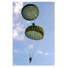 U.S. Army Soldiers parachute down after jumping fr Poster