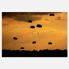 U.S. Army Soldiers parachute through the sky