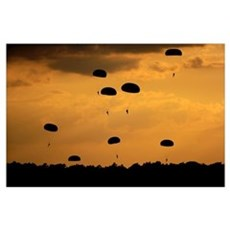 U.S. Army Soldiers parachute through the sky Poster