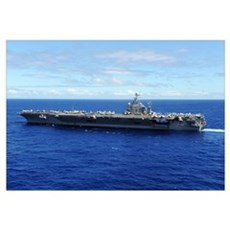 The aircraft carrier USS Abraham Lincoln transits  Framed Print