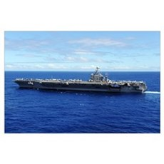 The aircraft carrier USS Abraham Lincoln transits  Poster