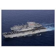 USS Kearsarge pulls alongside USNS Lewis and Clark