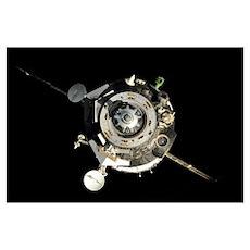 The Soyuz TMA 17 spacecraft departs the Internatio Poster