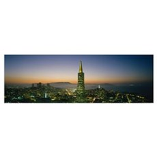Buildings lit up at dusk, Transamerica Pyramid, Sa Framed Print