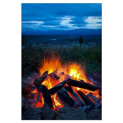 Close up view of a camp fire with a view of the Ch Framed Print