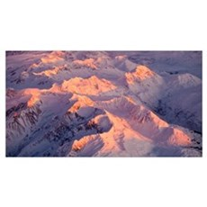 Aerial view of the Chugach Mountain range with sun Canvas Art