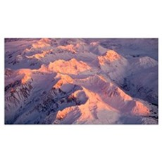 Aerial view of the Chugach Mountain range with sun Poster