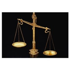 Golden Scales of Justice Out of Balance