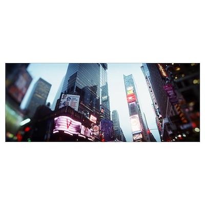 Buildings lit up at dusk Times Square Manhattan Ne Poster