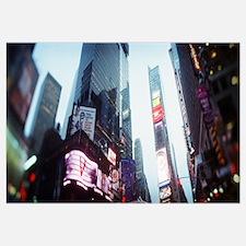 Buildings lit up at dusk Times Square Manhattan Ne