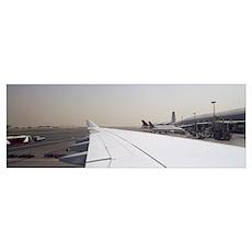 Airplanes at an airport Dubai International Airpor Poster